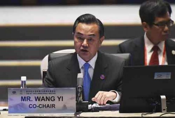 Chinas Foreign Minister Wang Yi speaks at the start of Asia-Pacific Economic Cooperation (APEC) Summit ministerial meetings at the China National Convention Centre (CNCC) in Beijing