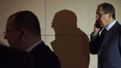 Russian Foreign Minister Sergei Lavrov makes his way to a meeting during the third day of closed-door nuclear talks at the Intercontinental Hotel in Geneva