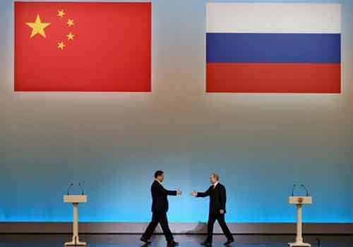 Председатель КНР Си Цзиньпин и президент России Владимир Путин в Государственном Кремлевском Дворце, Москва (фото из архива).