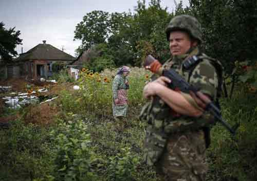 "A member of the Ukrainian police special task force ""Kiev-1"" patrols in Semenovka"