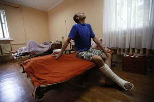 Injured pro-Russian separatists from the so-called Battalion Vostok (East) recuperate at a hospital in Donetsk