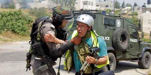 178439_Bilal_Tamimi_being_attacked_by_an_Israeli_soldier_at_a_protest_in_Nabi_Saleh_in_May_2013 (1)