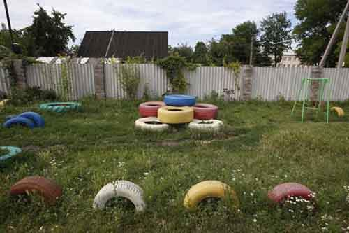 An empty playground is seen in a residential area of Donetsk
