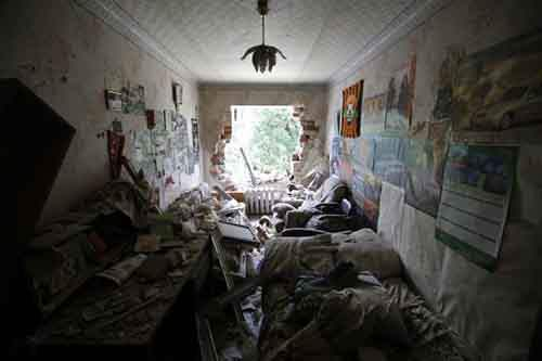 Interior view shows a damaged apartment building following what locals say was recent shelling by Ukrainian forces in the settlement of Maryinka outside Donetsk