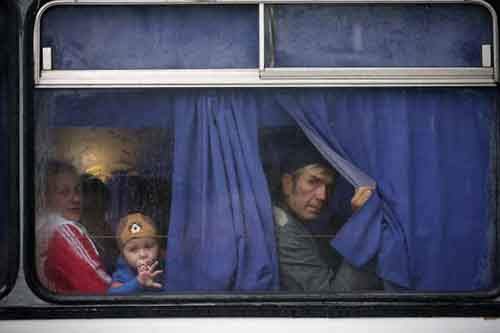 Residents of the Donetsk region in eastern Ukraine sit on a bus destined for Rostov-on-Don in Russia