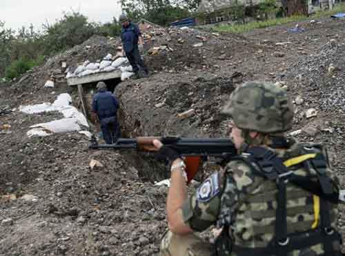Sappers check positions once held by pro-Russian separatists in Semenovka