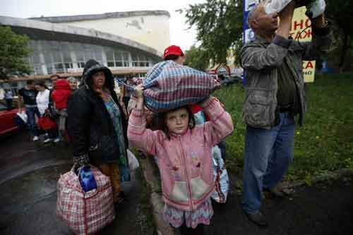 Residents of the Donetsk region in eastern Ukraine prepare to board buses for Rostov-on-Don in Russia