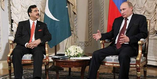 Russia's Prime Minister Vladimir Putin, right, and Pakistani Prime Minister Gilani speak d