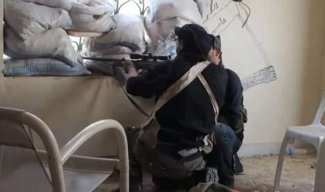 Syrian_rebel_sniper-e1406756573592