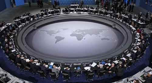 528182-leaders-of-the-g20-summit-gather-around-the-meeting-table-for-the-first-plenary-session-of-the-summi