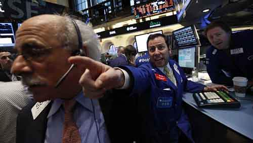 Barclays specialist trader Michael Pistillo shouts out a price just after the opening bell on the floor at the New York Stock Exchange