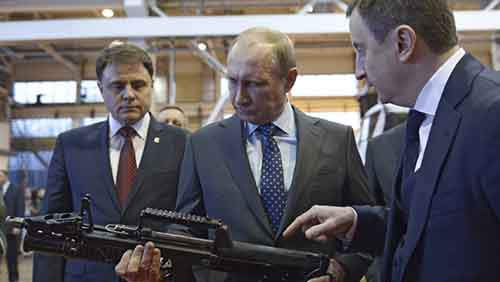 Russia's President Putin holds a weapon during his visit to an arms factory in Tula