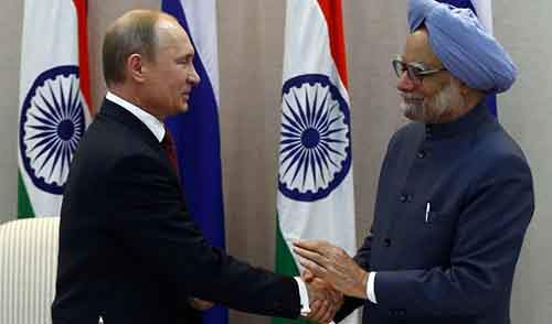 Russia's President Putin shakes hands with India's Prime Minister Singh after a press statement following signing ceremony in New Delhi