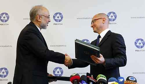 Kiriyenko, head of the Russian state nuclear monopoly Rosatom, and head of Iran's Atomic Energy Organisation Salehi shake hands during a signing ceremony in Moscow