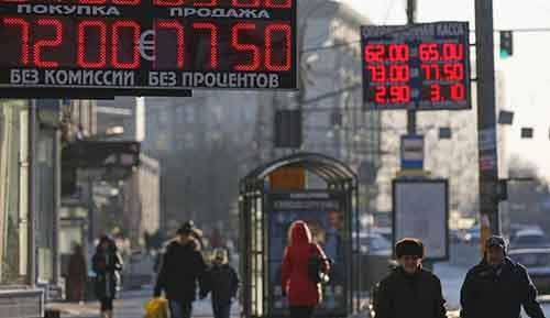 Boards showing currency exchange rates are seen in Moscow
