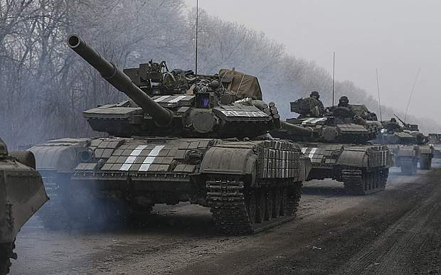 Ukrainian servicemen ride on a tank near Debaltseve
