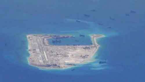 Still image from a United States Navy video purportedly shows Chinese dredging vessels in the waters around Fiery Cross Reef in the disputed Spratly Islands