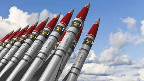Nuclear missiles against blue sky