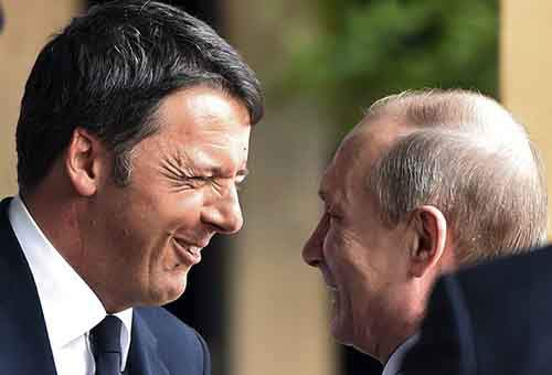Italian PM Renzi smiles as he meets Russian President Putin at the Expo 2015 global fair in Milan