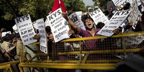 A Krantikari Yuva Sangathan (KYS) activist shouts slogans during a protest against the killing of a 52-year-old Muslim farmer Mohammad Akhlaq, in New Delhi, India, Sunday, Oct. 11, 2015