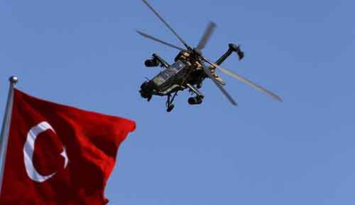 Turkish Attack and Tactical Reconnaissance Helicopter (ATAK) performs a manoeuvre during a ceremony marking the 93rd anniversary of Victory Day in Ankara