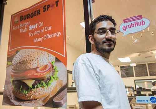 The Burger Spot owner Mohammed Abdoun. The restaurant delivers within five miles fro the location and receives orders by phone calls, web, and apps. ///ADDITIONAL INFORMATION: david.OrderOut.11xx-11/23/15- KYUSUNG GONG, STAFF PHOTOGRAPHER – Column on rise of home delivery food from variety of places, restaurnts and such.