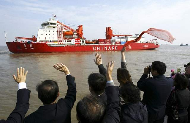 Relatives and friends of researchers and crew members wave as Xue Long (Snow Dragon) leaves the port on an Antarctica research mission in Shanghai November 12, 2007. This Chinese research team which consists of 188 researchers, scientists, professionals and crew members is the largest Chinese team for Antarctica after the first one in 1984. The research team will stay there for about 150 days and the country's third research station on the icy continent will be completed in two years. According to China Daily. REUTERS/Stringer (CHINA) CHINA OUT - RTX8W8