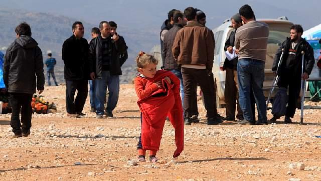 Сирийская девочка из Алеппо в лагере для беженцев в селе Батабо на севере провинции Идлиб, Сирия, 14 февраля