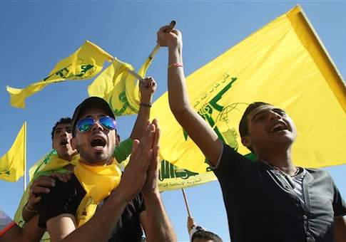 "Hezbollah supporters shout slogans and wave Hezbollah flags, during a rally commemorating ""Liberation Day,"" which marks the withdrawal of the Israeli army from southern Lebanon in 2000, in the southern border town of Bint Jbeil, Lebanon, Sunday, May 25, 2014. Hezbollahís leader Sheik Hassan Nasrallah is warning that hardline foreign fighters in Syria pose a global threat as they return home. Nasrallah accused European countries of easing the flow of extremist fighters into Syria, where they have fought against the rule of President Bashar Assad. (AP Photo/Hussein Malla)"