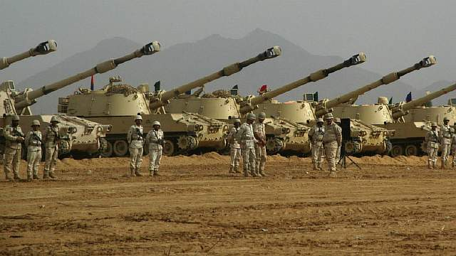 Saudi-troops-tanks-m