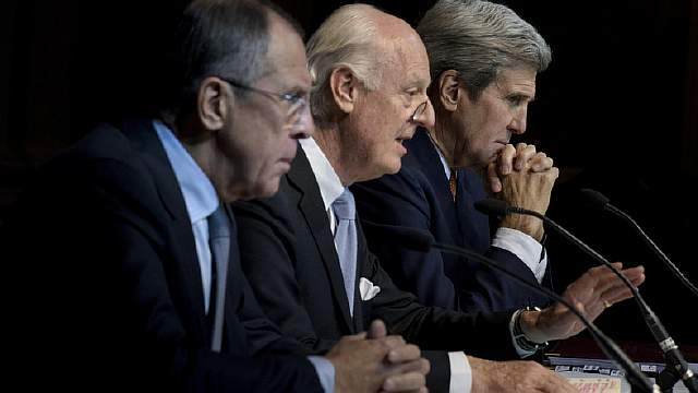 Russian Foreign Minister Lavrov and US Secretary of State Kerry listen while UN Special Envoy for Syria de Mistura speaks during a news conference at the Grand Hotel in Vienn