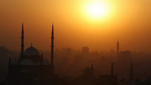 The sun sets over the Muhammad Ali Mosque at the Citadel in Cairo June 14, 2009. REUTERS/Asmaa Waguih (EGYPT RELIGION CITYSCAPE)