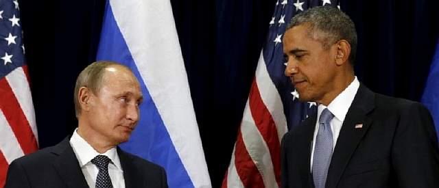 Подпись к изображению: Президент США Барак Обама и российский президент Владимир Путин смотрят друг на друга во время встречи в Генеральной Ассамблее ООН в Нью-Йорке, 28 сентября 2015 года