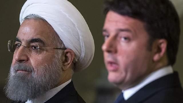 Подпись к изображению: Хасан Рухани и Маттео Ренци во время встречи в Риме