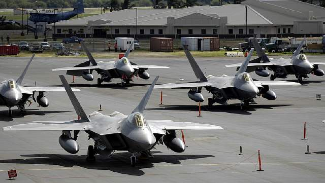 F-22 Raptors sit on the flight line