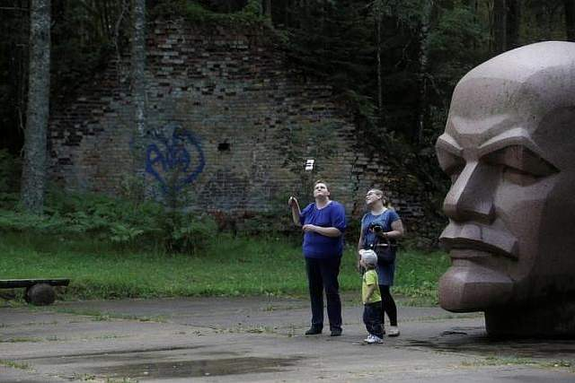 People take a selfie at the abandoned former Soviet R12 nuclear missile launch site in Zeltini. The Zeltini missile launch site, operational during the Cold War years from 1962 to 1984 when Latvia was under Soviet rule, at one time concealed at least eight nuclear missiles in its hangars. REUTERS/Ints Kalnins