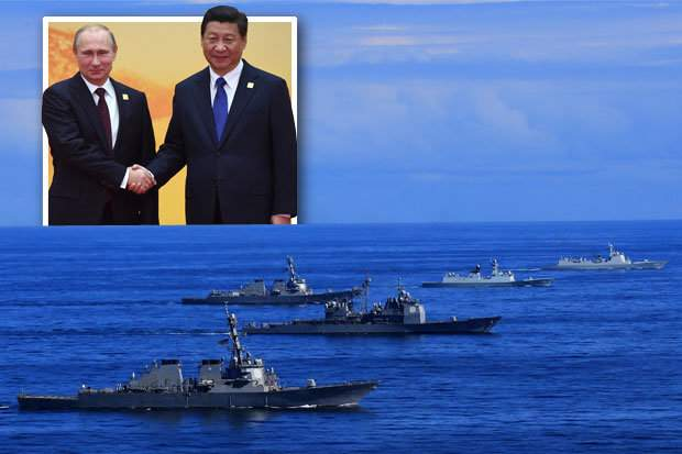 Подпись к изображению: Россия и Китай проводят совместные военно-морские учения в Южно-Китайском море