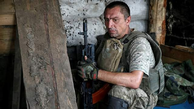 Ukrainian serviceman is seen at his position on the front line in Krasnogorovka