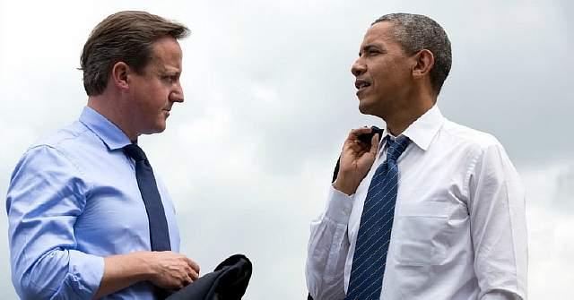 Подпись к изображению: Президент США Барак Обама и британский премьер-министр Дэвид Кэмерон беседуют на саммите большой восьмерки в Северной Ирландии, 17 июня 2013 года