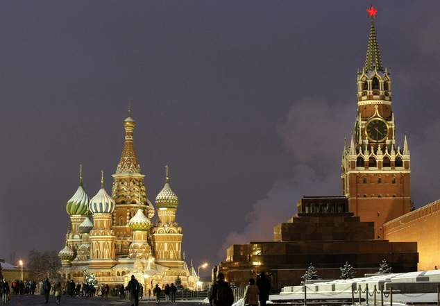 FILE - In this Dec. 10, 2009, file photo, people walk in Red Square, with St. Basil Cathedral, left, the Kremlin's Spassky Tower, right back, and Lenin Mausoleum, right, in Moscow, Russia. Russia cannot be ignored. Since the end of the Cold War, Russia has never posed such a vexing problem to U.S. policymakers as it does now. From Eastern Europe to the Middle East and increasingly Asia and the Americas, Russia is making its voice heard and its presence felt. (AP Photo/Misha Japaridze, File)