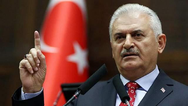 Подпись к изображению: Турецкий премьер-министр и лидер правящей партии Справедливости и развития (AK Party) Бинали Йылдырым выступает в ходе партийного заседания в Национальной Ассамблее в Анкаре, 1 ноября 2016 года