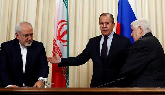 Подпись к изображению: Российский министр иностранных дел Сергей Лавров и его коллеги Валид Муаллем из Сирии и Джавад Зариф из Ирана, во время пресс-конференции в Москве, 28 октября 2016 года.