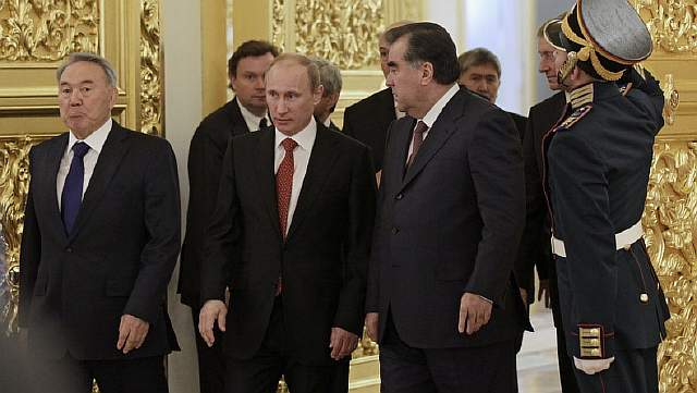 Kazakhstan's President Nazarbayev, Russia's President Putin and Tajikistan's President Rahmon enter a hall during the CSTO summit at the Kremlin in Moscow