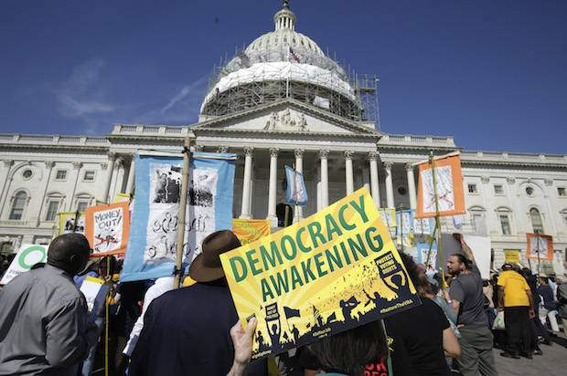 Pro-Democracy protesters rally in front of the U.S. Capitol in Washington April 18, 2016. REUTERS/Joshua Roberts - RTX2AHUJ