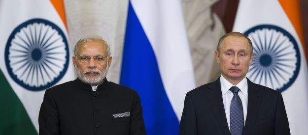 Russian President Vladimir Putin, right, and Indian Prime Minister Narendra Modi pose for a photo after a news conference following their meeting with Russian and Indian officials and businessmen in the Kremlin in Moscow, Thursday, Dec. 24, 2015. (AP Photo/Pavel Golovkin)