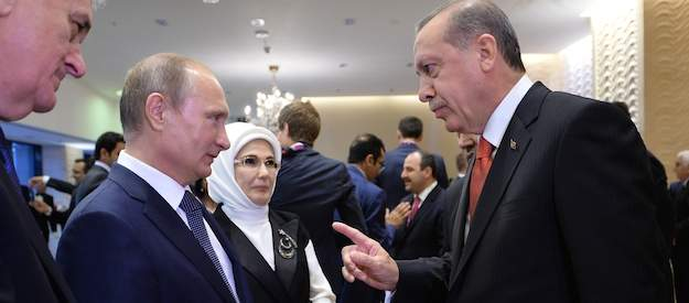 2641156 06/12/2015 Presidents Vladimir Putin (second left) of Russia, Recep Tayyip Erdogan (right) of the Turkish Republic and Tomislav Nikolic (left) of serbia to attend the opening ceremony of the First European Games in Baku, June 12, 2015./The press-service of the Preside