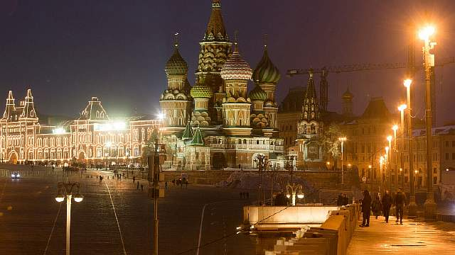 The GUM luxury department store, left, sits illuminated at night on Red Square near St. Basil's cathedral in Moscow, Russia, on Wednesday, Nov. 9, 2016. Russia is realistic about limits on the prospects for an immediate improvement in relations with the U.S. after President-elect Donald Trump takes office, according to President Vladimir Putin's spokesman. Photographer: Andrey Rudakov/Bloomberg