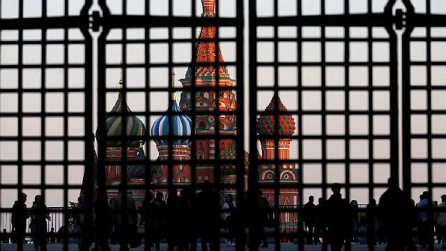 FILE PHOTO: St. Basil's Cathedral is seen through a gate in Red Square in central Moscow, September 18, 2014. REUTERS/Maxim Zmeyev/File Photo