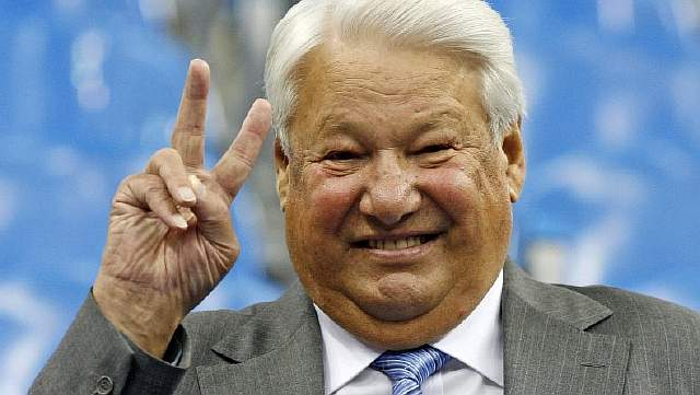 Russian former President Boris Yeltsin gestures as he attends a tennis match between Russian Marat Safin and U.S. player Andy Roddick at the Davis Cup semifinal match in Moscow, Friday, Sept. 22, 2006. (AP Photo/Misha Japaridze)