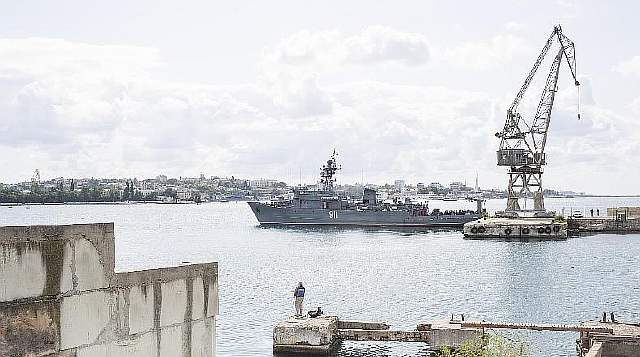 A Russian Navy vessel in Sevastopol, the Black Sea port city in Russian-annexed Crimea, Aug. 31, 2017. Taking back Crimea by force in 2014 was celebrated across Russia as a long-overdue restoration of lost superpower might. For many here, however, the euphoria has gone as flat as old champagne. (Denis Sinyakov/The New York Times) ##########x##########